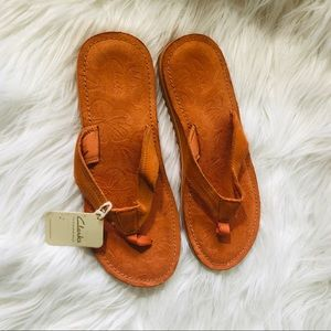 Clark's women's orange leather upper slippers